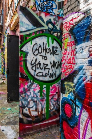 vandalize: Graffiti on doors in Graffiti Alley, Baltimore, Maryland.