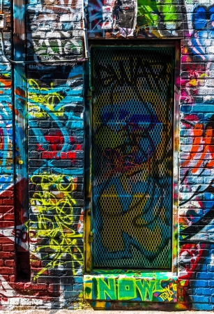 Graffiti on walls and door in Graffiti Alley, Baltimore, Maryland. Editorial