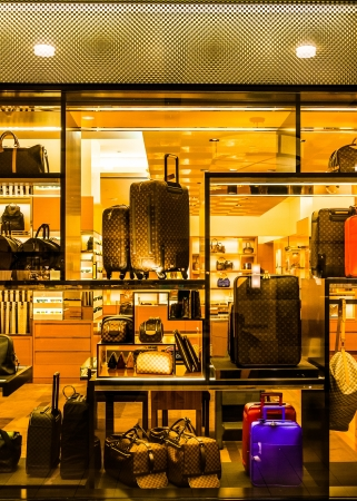 Suitcases and bags in a store window, in Towson, Maryland.