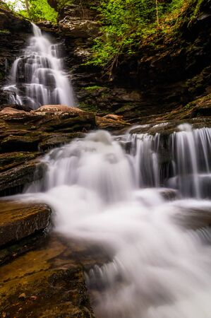 Tall waterfall and cascades on Kitchen Creek in Ricketts Glen State Park, Pennsylvania. Stock Photo - 20759442