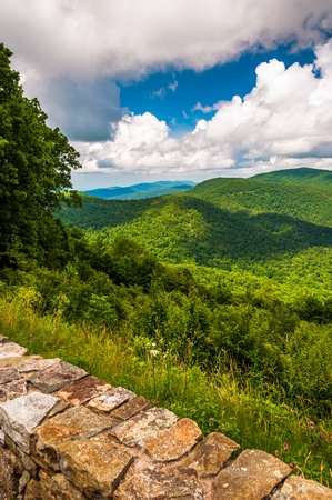 Stone wall and view of the Blue Ridge at an overlook on Skyline Drive in Shenandoah National Park, VA.