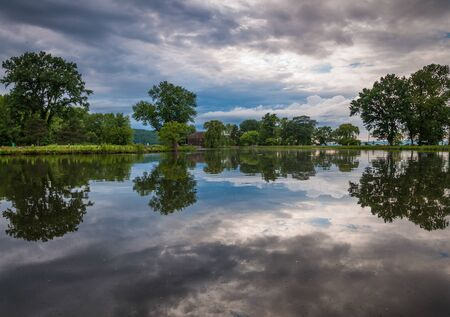 Storm clouds reflect in a pond at Stewart Park in Ithaca, New York. photo
