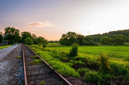 Sunset over railroad tracks and fields in York County, Pennsylvania.