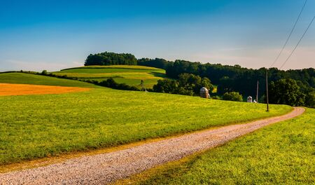 backroad: Dirt driveway to a farm and fields in Southern York County, Pennsylvania.