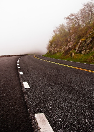 disappears: Skyline Drive disappears into fog, in Shenandoah National Park, Virginia.