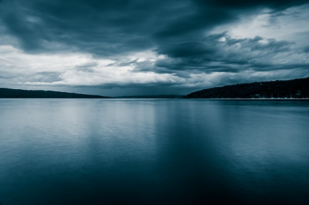 stormy waters: Dark storm clouds over Cayuga Lake, in Ithaca, New York.
