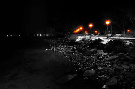 Lamps and rocks along the shore of the Chesapeake Bay at night, in Havre de Grace, Maryland. photo