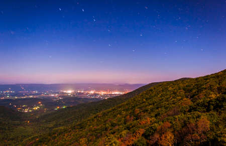 Star trails over the Shenandoah Valley at night, seen from Crescent Rock in Shenandoah National Park, Virginia. photo