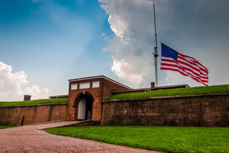 Summer storm clouds and American flag over Fort McHenry in Baltimore, Maryland.
