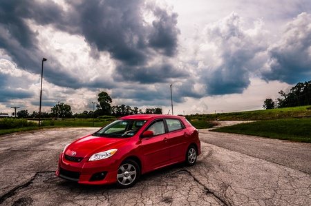 A Toyota Matrix in a old parking lot. Editorial