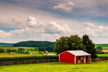 Small red stable and view of farms in Southern York County, Pennsylvania. photo