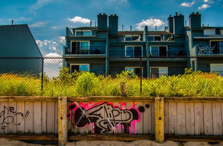 Graffiti on wooden fence in front of waterfronts condos in Point Pleasant Beach, New Jersey.