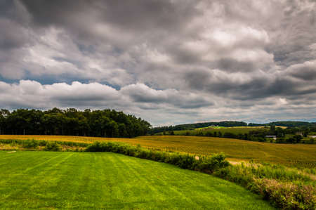 Storm clouds over farm fields in rural York County, Pennsylvania. Stock Photo - 21717816