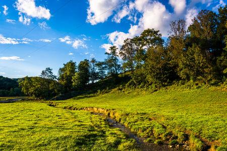 A small stream through a field in rural York County, Pennsylvania.