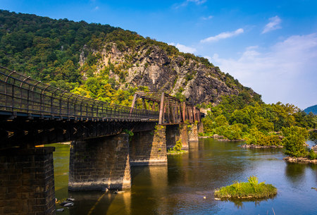 west virginia trees: Bridge over the Potomac River and view of Maryland Heights, in Harpers Ferry, West Virginia. Stock Photo
