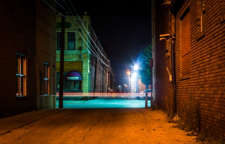 Dark alley and light trails in Hanover, Pennsylvania at night. photo