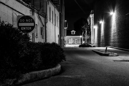 dark alley: Do Not Enter sign in a dark alley at night in Hanover, Pennsylvania. Stock Photo