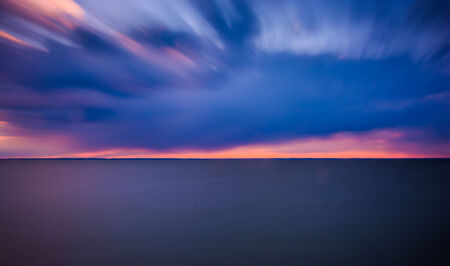 Long exposure on the Chesapeake Bay at sunset, from Tilghman Island, Maryland. Stock Photo - 25059511