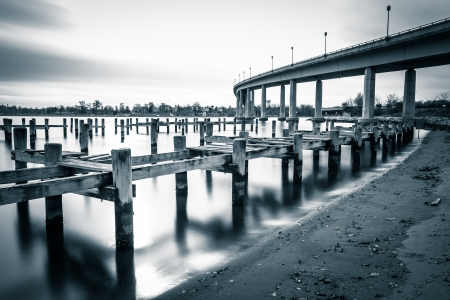 severn: Pier posts in the Severn River and the Naval Academy Bridge, in Annapolis, Maryland.