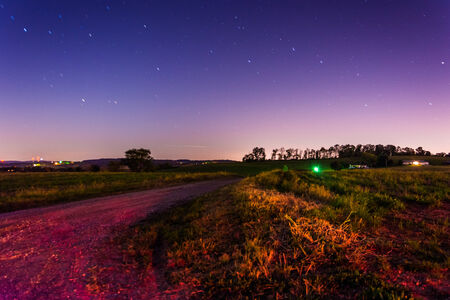 Startrails over a country road at night, in rural York County, Pennsylvania. photo