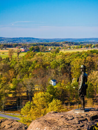 Statue and view battlefields from Little Round Top, in  Gettysburg, Pennsylvania. Stock Photo