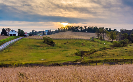 amish: Sunset over farm fields and hills in Lancaster County, Pennsylvania.