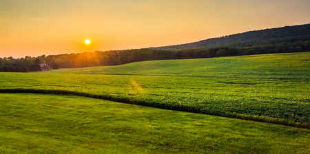 Sunset over farm fields in rural York County, Pennsylvania. photo