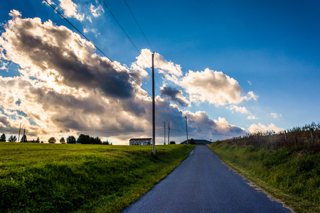 Sunset sky over a country road near Cross Roads, Pennsylvania. photo