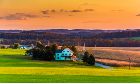 View of rolling hills and farm fields at sunset in rural York County, Pennsylvania. Reklamní fotografie