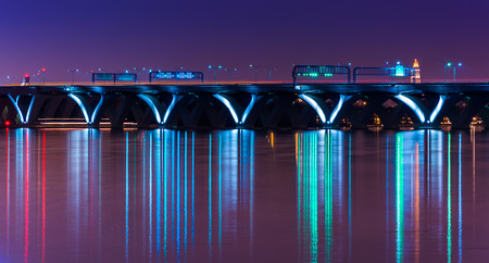 wilson: The Woodrow Wilson Bridge at night, seen from National Harbor, Maryland. Stock Photo