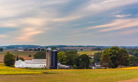 View of a barn and silos on a farm in rural Lancaster County, Pennsylvania.