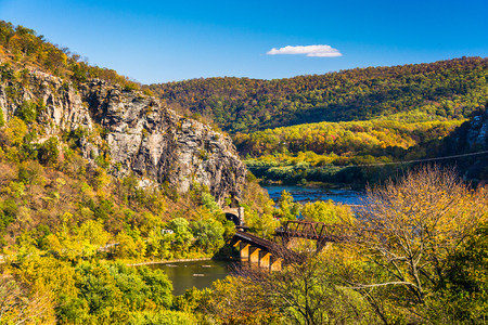 west virginia trees: View of train bridges and the Potomac River in Harpers Ferry, West Virginia. Stock Photo