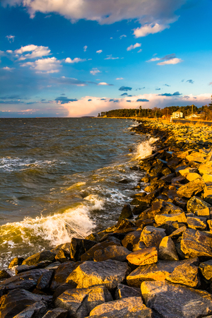 Waves on rocks on the Chesapeake Bay, in Tilghman Island, Maryland. photo