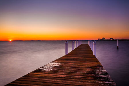 pilings: A pier at sunset, Kent Island, Maryland. Stock Photo