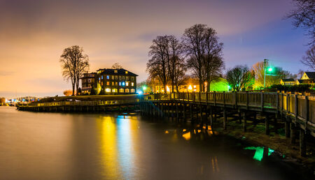 Boardwalk along the waterfront at night, in Havre de Grace, Maryland. photo