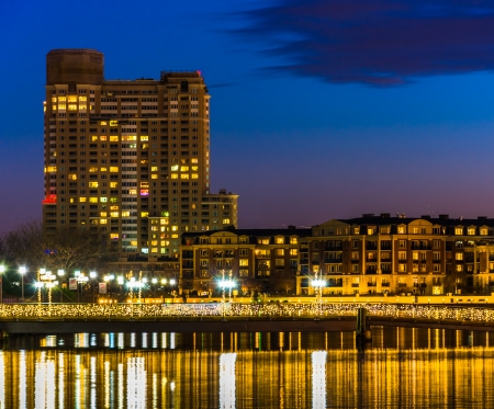 Bridge and buildings at night, at the Inner Harbor of Baltimore, Maryland. photo