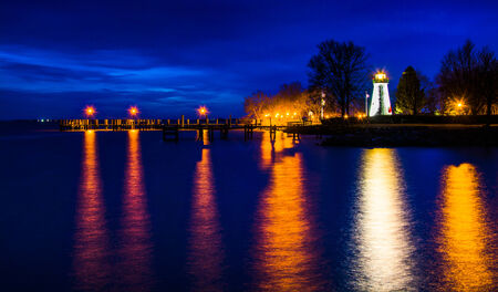 Concord Point Lighthouse and a pier at night in Havre de Grace, Maryland. photo