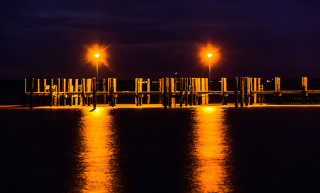 Lights on a fishing pier at night, in Havre de Grace, Maryland.