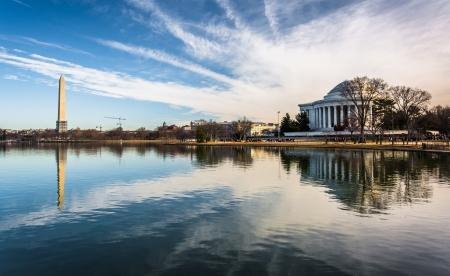 washington dc: The Washington Monument and Thomas Jefferson Memorial reflecting in the Tidal Basin, Washington, DC. Editorial