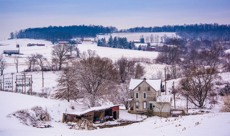 Old house and the snow covered landscape of rural York County, Pennsylvania. photo