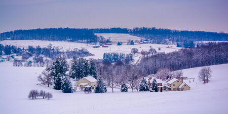 covered fields: Snow covered fields and rolling hills in rural York County, Pennsylvania. Stock Photo