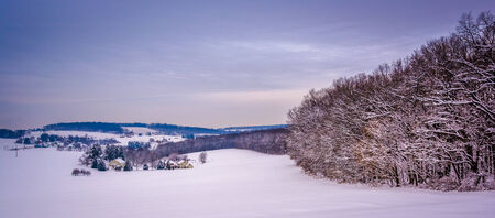 View of snow-covered rolling hills in rural York County, Pennsylvania  photo