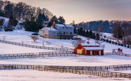 Winter view of a house and barn on farm in rural Carroll County, Maryland. photo