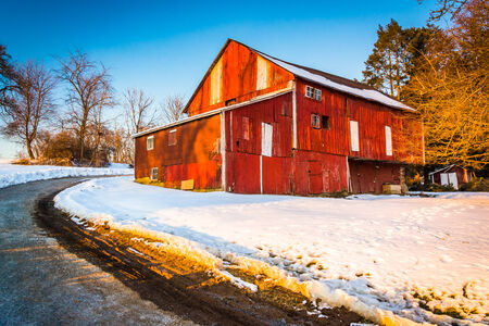 backroad: Red barn during the winter in rural York County, Pennsylvania.
