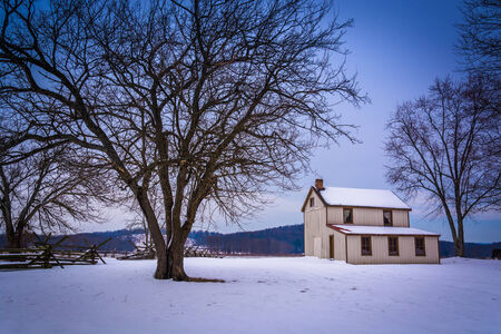 small house: Small house and trees in a snow-covered field in Gettysburg, Pennsylvania.
