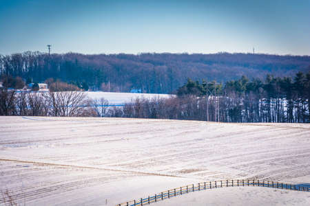 View of snow-covered farm fields in rural York County, Pennsylvania.