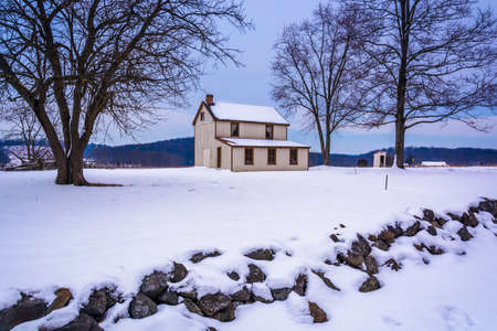 Small house in a snow-covered field in Gettysburg, Pennsylvania. Editorial