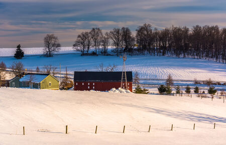 View of a barn and snow-covered hills in rural York County, Pennsylvania. photo