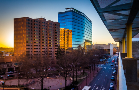 View of buildings along 11th Street at sunset in downtown Wilmington, Delaware, from the City Center Parking Garage. Stock Photo