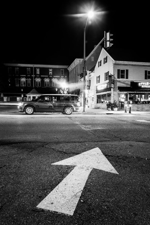 Arrow on pavement and intersection at night in Hanover, Pennsylvania.